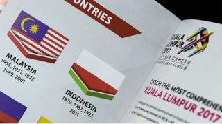 This photo illustration taken on 20 August 2017 shows the Indonesian flag printed upside-down in a copy of the souvenir magazine for the 29th Southeast Asian Games (SEA Games) in Kuala Lumpur.