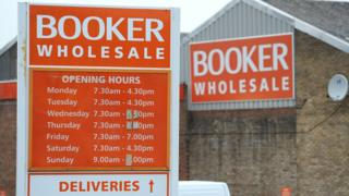 Sign outside a Booker warehouse