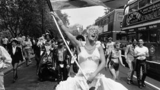 A marcher dressed as Marilyn Monroe during the annual Gay Pride march in London, July 1994