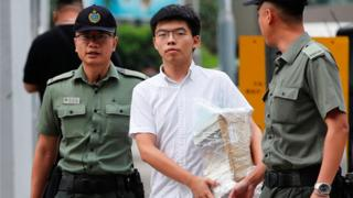 Former student leader Joshua Wong walks out from prison after being jailed for his role in the Occupy Central movement,