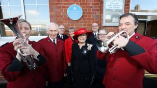 Major David Burns, North East England area leader for the Salvation Army, Sue Snowdon, Lord Lieutenant of County Durham, and Kelsey Thackeray with band members