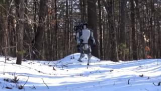 Atlas robot walking in the snow.