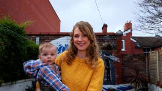 Jo Tapley with son Oswin in the back garden of her home in Lime Road
