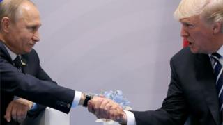 Donald Trump President Putin and President Trump, shaking hands at the G20 summit in Hamburg, Germany in 2017