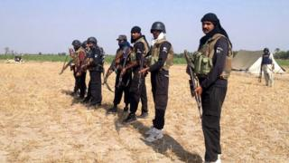 Pakistani policemen pose as they prepare to take part in an operation against alleged criminals in Rajanpur district in southern Punjab province
