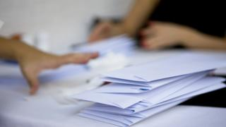 Child's hand and envelopes
