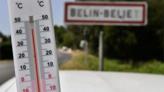 A thermometer in the south-western French village of Belin-Beuet during the heatwave on 23 July 2019