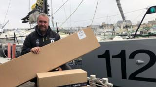Alex Alley with the new components and his yacht Pixel Flyer in Brest
