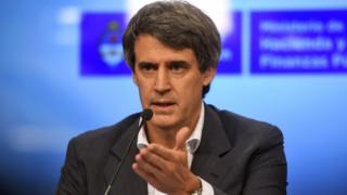 Argentinian Finance Minister Alfonso Prat-Gay speaks during a press conference in Buenos Aires on December 16, 2015. Argentina said Wednesday it will eliminate the foreign exchange restrictions that have propped up the official value of the peso since 2011, setting up a potentially painful devaluation