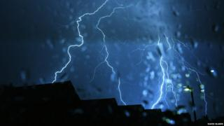 Lightning storm over rooftops