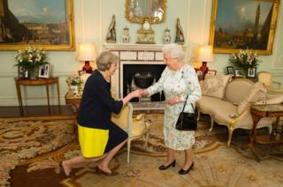 Queen Elizabeth II welcoming Theresa May at the start of an audience in Buckingham Palace, London
