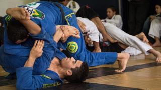 Brazilian jiu-jitsu fighters grappling