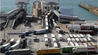 Lorries arrive and depart from the Dover Ferry Terminal
