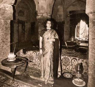 Begum Wilayat Mahal pictured with her fine Persian carpets