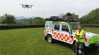 The drone being operated by a member of the team