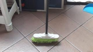 Broom standing upright