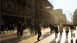 People walking in the sun on Buchanan Street in Glasgow