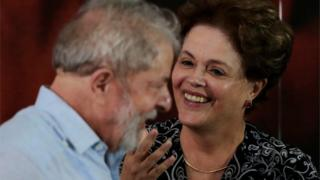 Former Brazilian president Luiz Inacio Lula da Silva speaks with former President Dilma Rousseff during a meeting with members of the Workers Party (PT), that decided Lula da Silva will be its candidate again in the 2018 election,