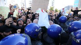 Algerian protesters chant slogans during a demonstration protest
