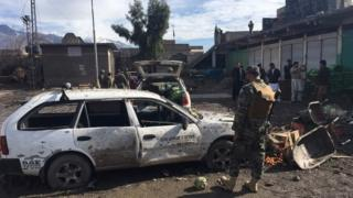 Pakistani security officials inspect the bomb explosion site at a vegetable market in Parachinar city, the capital of Kurram tribal district on the Afghan border on January 21, 2017.