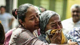 Distraught relatives in Mexico