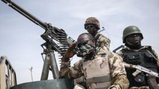 Three soldiers wey siddon on top tanker.