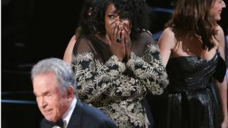 Moonlight editor Joi McMillon looks on, with award presenter Warren Beatty in the foreground