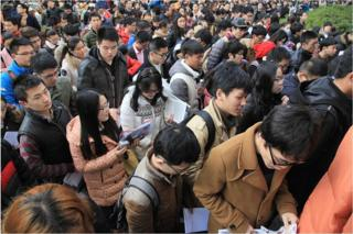 Candidates prepare outside the civil service examination room at Nanjing Forestry University on 29 November 2015 in Nanjing, Jiangsu Province of China. About 1.4 million people signed up for the civil service examination for 270,000 places this year.