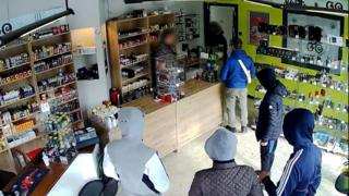 CCTV footage show six thieves, allegedly armed, talking with the shop owner