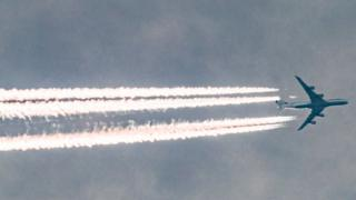 Airplane leaving trails in the sky