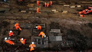 Archaeologists work on the excavation in London