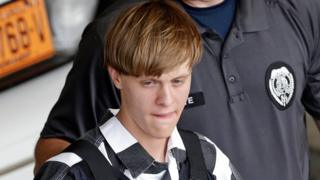 Dylann Roof, wearing a bullet proof vest, is escorted from the Cleveland County Courthouse