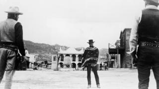 Clint Eastwood stares down his adversaries during a showdown in a still from the film, A Fistful of Dollars
