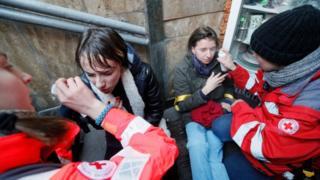 Paramedics rinsing the eyes of activists