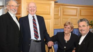 Members of Tynwald celebrate the retirement of messengers Derek and Joy Brown (pictured centre)