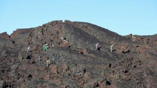 Geologists at work on the Sierra Negra volcano