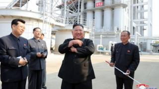 Kim Jong-un pictured by state media opening a fertiliser factory 1 May 2020