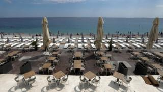 Tables and deckchairs are set out to respect social distancing on the Promenade des Anglais beach in Nice