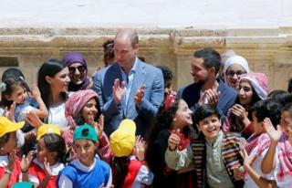 Prince William and Jordan's Crown Prince Hussein interact with children at the ancient city of Jerash