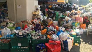 Piles of supplies donated to Grenfell Tower victims