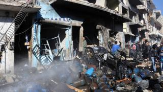Gas cylinders in the debris of a car bomb attack in a government-controlled area of Homs