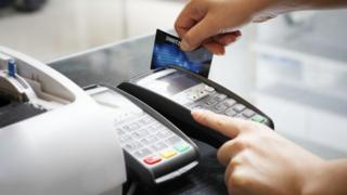 Credit card being swiped in a payment machine