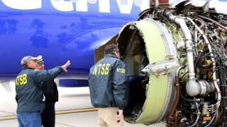Investigators examine damage to the CFM International 56-7B turbofan engine belonging to Southwest Airlines Flight 1380 that separated during flight on April 17, 2018