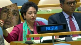 Pakistan's permanent UN representative Maleeha Lodhi holds up a photo of an injured girl at the General Assembly. The photo is of a girl in Gaza, but Lodhi claims it is from Kashmir.