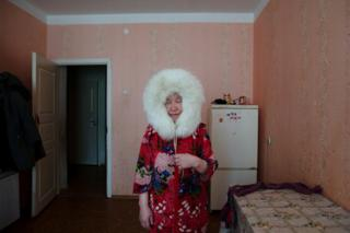 Pudani Audi (born.1948) in her apartment. Yar-Sale village, Yamal Peninsula, Siberia, Russia.