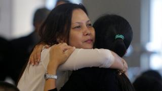 Relatives of missing MH370 passengers console one another as the official report is released, Malaysia, 30 July 2018