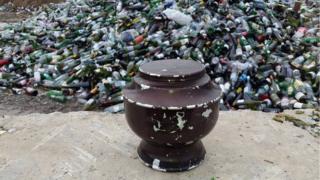 Urn in bottle bank by Corlett Building Materials