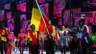 Flag bearer Yemi Geoffrey Apithy (C) of Benin leads his team into the Maracana Stadium during Friday's opening Ceremony of the Rio 2016 Olympic Games in Rio de Janeiro, Brazil.