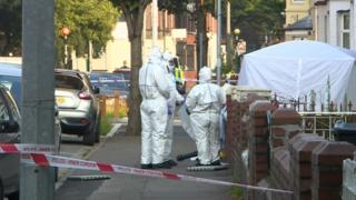Forensic teams outside property on Corporation Road in Grangetown, Cardiff