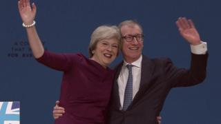 Theresa May and her husband Philip after the speech